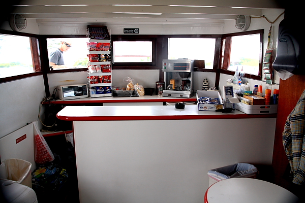 coffe bar on board the captain whittaker serving snack food, coffee, pepsi, water and chips